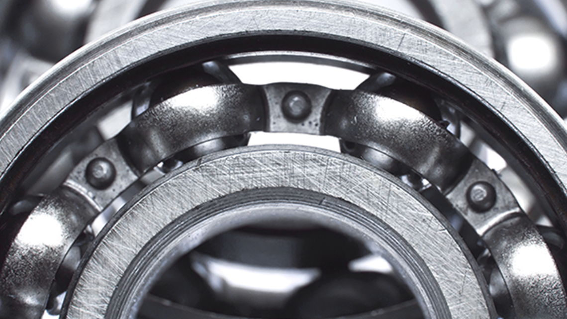 Close-up of ball bearings in dark steel gray